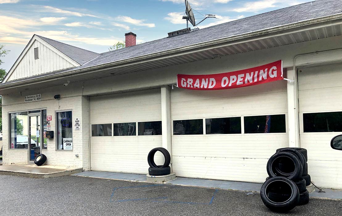 Brown's Garage with Grand Opening banner